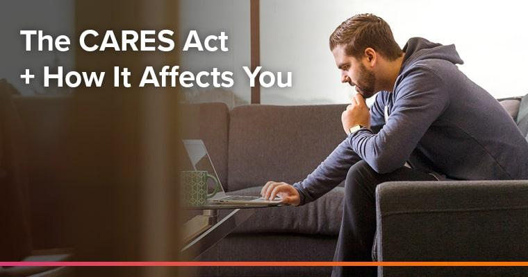Man sitting at computer, CARES Act.