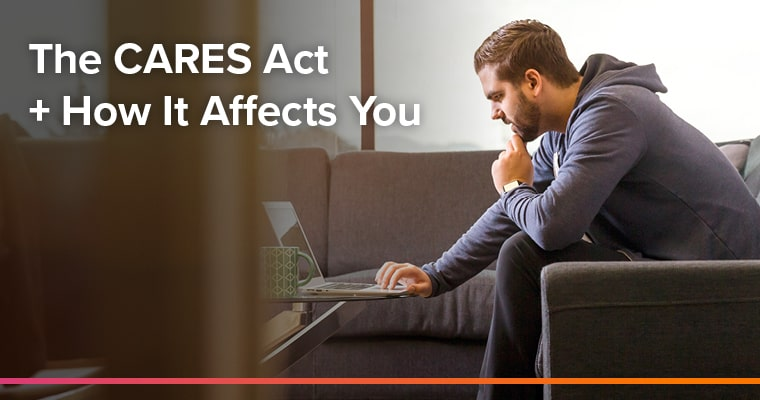 Man sitting at computer, CARES Act.