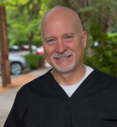 Dr. Branen smiling in his dental scrubs
