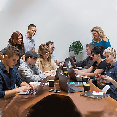 Roadside's marketing team gathered in a collaboration meeting