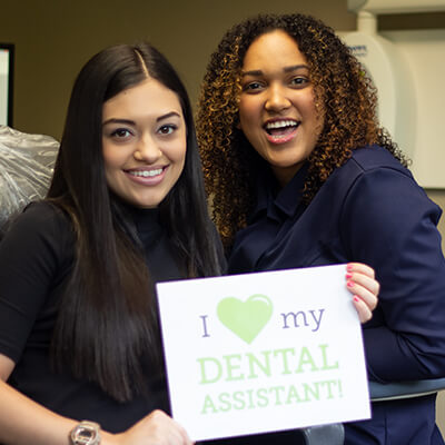 A dental assistant and patient using marketing tools from Roadside Dental Marketing