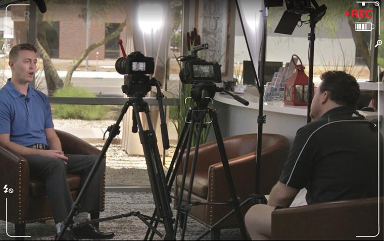 A professional videographer recording a dentist