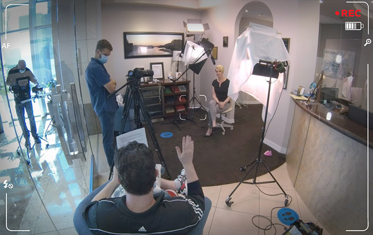 A professional video shoot set up at a dental practice